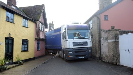 The scene in Woolpit after a lorry got stuck after hitting a building on a narrow street Picture: PH