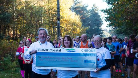 Suffolk Coastal representatives with a giant cheque at the first Honour Run Picture: SCDC