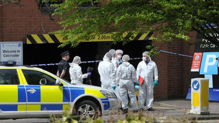 Forensics investigate the scene at St Mary's car park Picture: SARAH LUCY BROWN