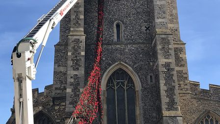 Fire crews helped hang the stunning cascade of poppies at St Peter's in Sudbury Picture: SUDBURY TOW