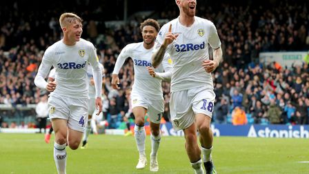 Leeds United's Pontus Jansson (right) celebrates. The Yorkshire side surged to the top of the table
