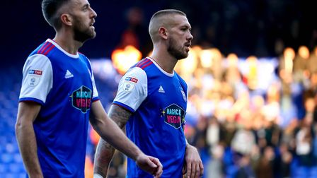Cole Skuse and Luke Chambers walk from the pitch following Saturday's limp 2-0 home defeat to QPR. P