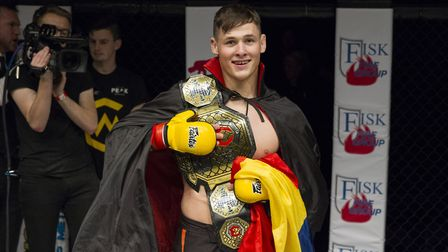 George Tanasa with the Cage Warriors Academy South East lightweight title after beating Nathan Philp