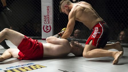 Eric Veyrier hits the off-switch on Perry Snooks on the way to a 24-second KO win at Cage Warriors A