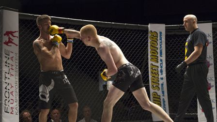 Ollie Sarwa lands a good right hand on his way to victory at Cage Warriors Academy South East. Pictu
