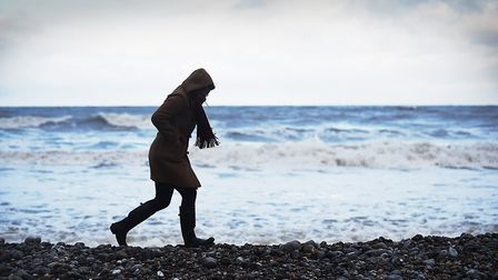 A walker struggles against the elements as the cold snap closes in Picture: Ian Burt