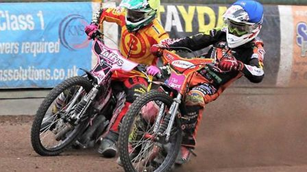 Drew Kemp, in blue, leads the Mildenhall attack on Thursday night in the play-off final against East