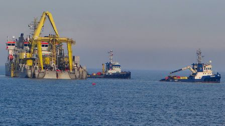 A cable laying vessel about quarter of a mile off the beach at Sizewell Picture: PHILIP JONES