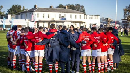 St Joseph's College players huddle before a game. Picture: MARK COVENTRY