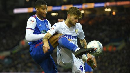 Jordan Spence gets to grips with Leeds' Mateusz Klich at Elland Road Picture Pagepix