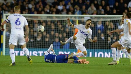 Flynn Downes catches a Leeds player at Elland Road Picture Pagepix