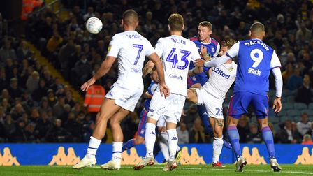 Matthew Pennington with a first half header on target at Leeds Picture Pagepix