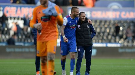 Ipswich manager Paul Hurst gets a hug from captain Luke Chambers after the win at Swansea City. Pict