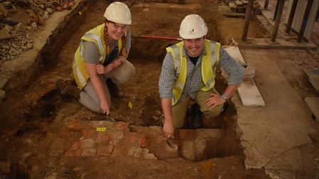 CAT archaeologists Sarah Carter and Ben Holloway with the remains of a brick plinth that would have