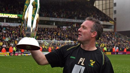 Norwich City Manager Paul Lambert lifts the Coca Cola League One Trophy at Carrow Road, Norwich.