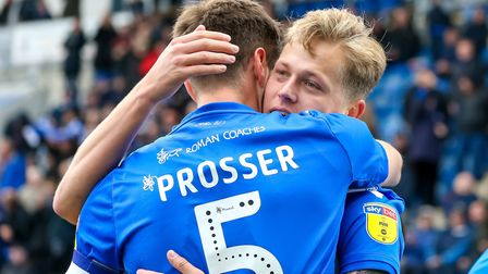 Luke Prosser congratulates team-mate Frankie Kent after the latter had given Colchester United the l