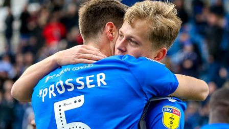 Frankie Kent is congratulated by Luke Prosser after scoring against Lincoln on Saturday. Picture: S