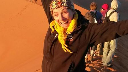 Award-winning tour guide Julie Gabbott with a tour party on the deserts of Namibia Picture: DRA