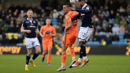 Jonas Knudsen loses out in the air at Millwall. Picture: PAGEPIX