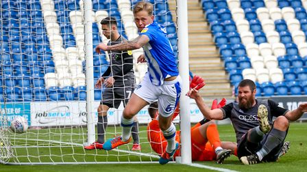 Frankie Kent wheels away after scoring the only goal in Colchester United's 1-0 victory over Lincoln