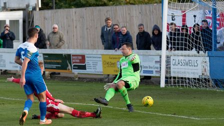 Ryan Jolland's shot beats Rhys Madden for the second Bury goal. Picture: PAUL VOLLER