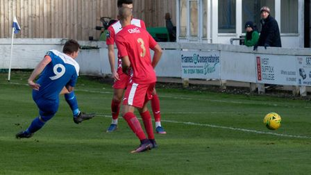 Ollie Hughes fires in the third goal for Bury in their win over Tilbury on Saturday. Picture: PAUL V
