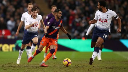Manchester City's Riyad Mahrez and Tottenham Hotspur's Mousa Dembele (right) battle for the ball at