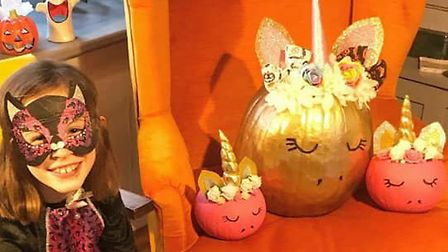 Pixie with her pumpkins she made with her mum. Picture: ANGIE-RICHARD CLIFTON
