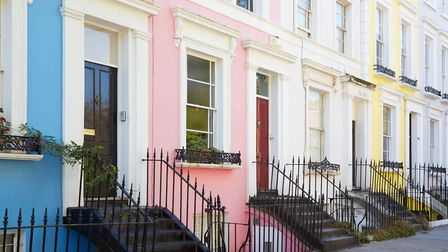 Colorful English houses facades in blue, pink, yellow and white, pastel colors