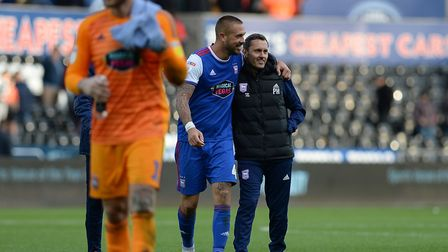 Luke Chambers gives Paul Hurst a hug after the 3-2 win at Swansea - it proved to be the only victory