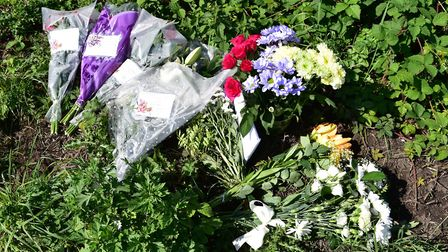 Floral tributes at the scene of the crash Picture: Nick Butcher
