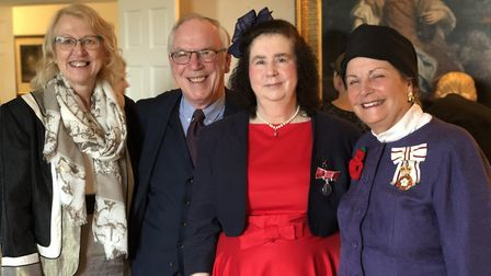 Linda Howe, second right, after receiving her BEM for services to the community in Honington and Sap