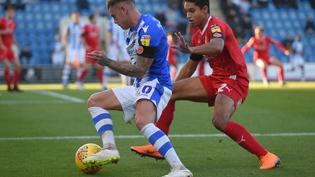 Sammie Szmodics tries to turn his marker during yesterday's 1-0 win over Swindon. Szmodics netted th