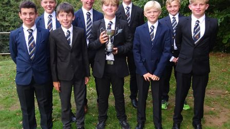 Teddy Hall, the four-handicap Bury St Edmunds junior, holds the Keith Bass Trophy, the individual pr