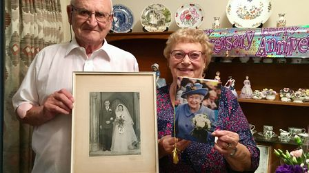 Peter and Eileen Burch proudly show their wedding photo and card from the Queen Picture:
