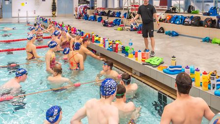 Dave Champion talks to his swimmers at Crown Pools in Ipswich. Picture: PAVEL KRICKA
