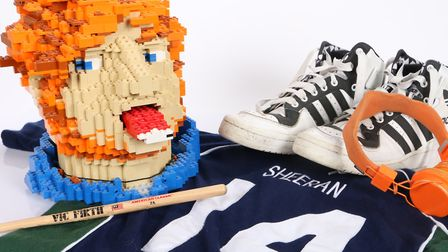 An array of Ed Sheeran memorabilia is up for auction including a pair of his shoes and a model of hi