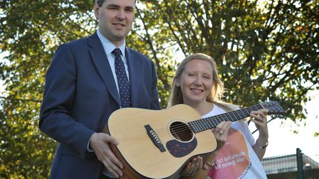 Oliver Miller and Helen Finlinson with Ed Sheeran's custom made guitar Picture: SARAH LUCY BROWN
