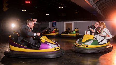 They were even photographed on the bumper cars dressed in their wedding clothes. Picture: CHRISTIAN