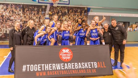 The Ipswich basketball girls and coaches celebrate after the presentation of the National Cup. Pictu