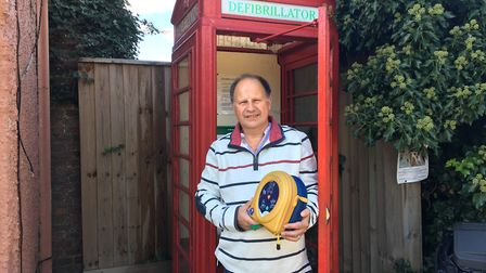 Stephen Laing with the defibrillator that saved Mr Harrison's life Picture: JAKE FOXFORD