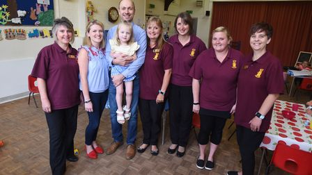 Annabel Brightwell and her parents with the life-saving staff at Barking Pre-School staff Picture: