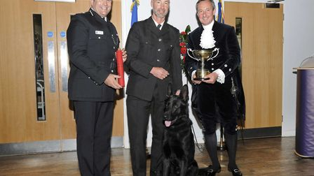 Chief Constable Gareth Wilson (left) and High Sheriff George Vestey present an award to Pc Stephen V
