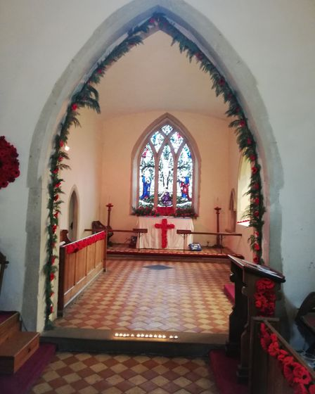 Some of the knitted poppies on display in St Gregory's Chruch in Barnham. Picture: SUE NUTT