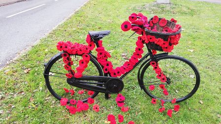 A bicydle decorated with knitted poppies in Barnham. Picture: SUE NUTT