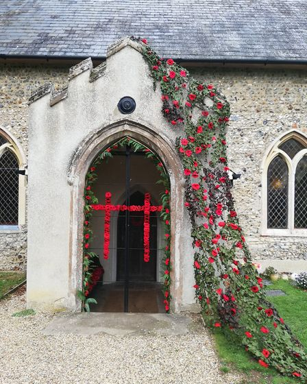 Two crosses created with knitted poppies at the entrance to St Gregory's Church, in Barnham. Picture