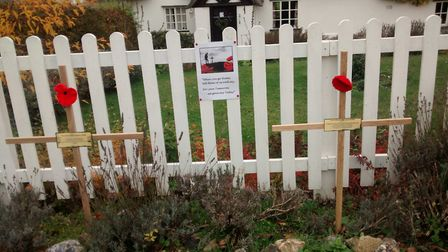 Two crosses outside the cottage of two brothers from Barnham who died in the First World War. Pictu