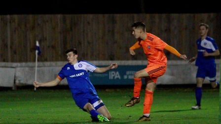 Lewis Reed scoring one of his two goals last night in the 3-0 win over Bury Town Picture: ROSS HALLS