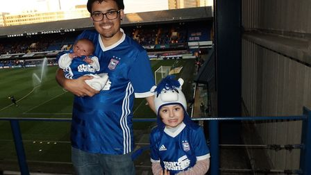 At only 14-days-old Michael Anthony Capeling attends his first match Picture: KRIS CAPELING