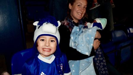It's a football mad family, Francesca Capeling and Rebecca Freed with Michael Picture: KRIS CAPELING